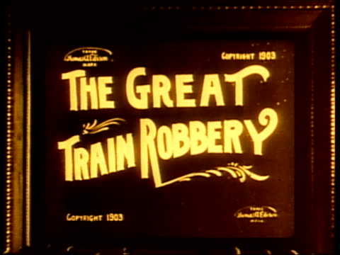 criminals shoot guns as they attempt to rob a train. - 無声映画点の映像素材/bロール