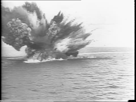 crippled hms barham turns over in the water / barham explodes sending debris and smoke in the air - anno 1941 video stock e b–roll