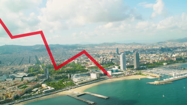 crisis at barcelona spain concept. falling down red line chart. barcelona coastline aerial view on the background - spain stock videos & royalty-free footage