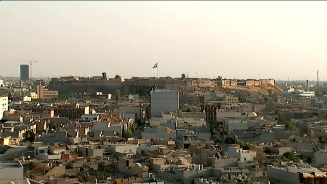 eu backs plans to arm kurdish fighters iraq irbil ext **call to friday prayers heard following sequence** long shot of large mosque with traffic... - main tower stock-videos und b-roll-filmmaterial
