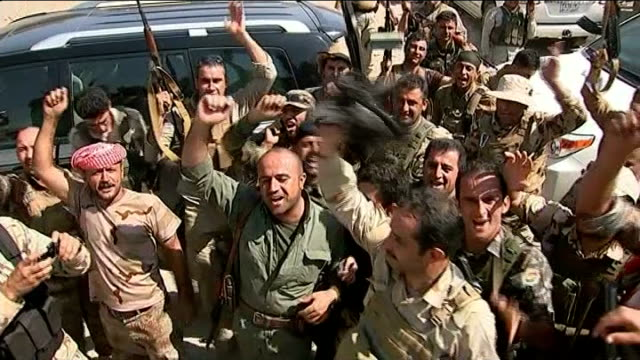 eu backs plans to arm kurdish fighters t10081417 tx group of kurdish peshmerga fighters holding up captured black isis flag and chanting sot various... - kurdischer abstammung stock-videos und b-roll-filmmaterial