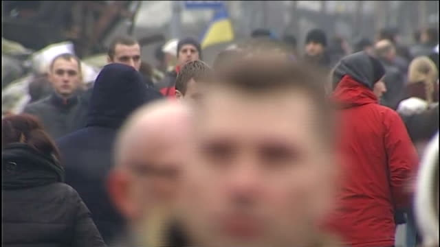 Kiev protest endures in Independence square UKRAINE Kiev EXT GV Protesters and barricades in Independence Square Smoke blowing across High Angle GV...