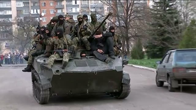 ProRussian supporters seize Ukrainian armoured vehicles ProRussian militia member interview SOT Talks of taking armoured vehicles from the Ukrainian...