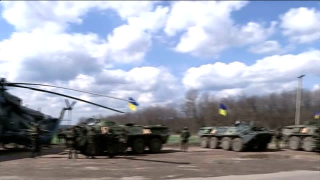 ukraine launches 'anti-terrorist operation' against pro-russian forces; izyum: ukrainian military helicopter hovers overhead as coming in to land... - military land vehicle stock videos & royalty-free footage