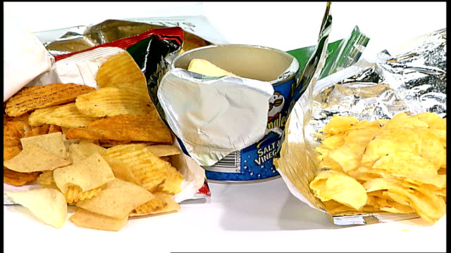 crisps fat warning; various crisp snacks on display - snack stock videos & royalty-free footage