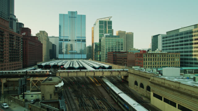crisscrossing trains in chicago - drone shot - chicago 'l' stock videos & royalty-free footage