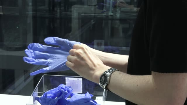 cristina is seen putting on a latex gloves as the new protocols for action and protection against the covid 19 pandemic for clients during the... - glove stock videos & royalty-free footage