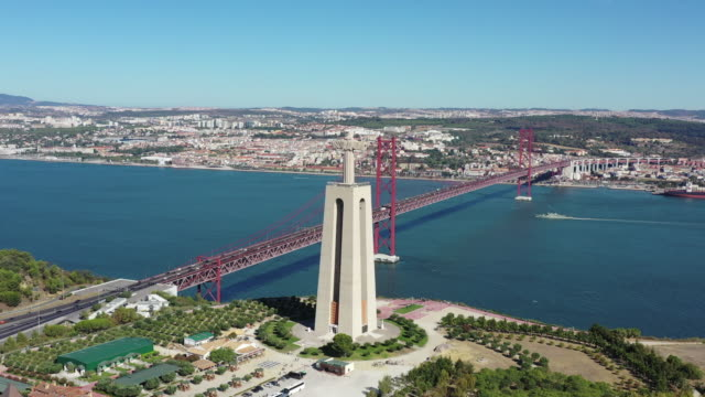 cristo rei (statue of christ) and 25 de abril bridge / lisbon, portugal - protestantism stock videos & royalty-free footage