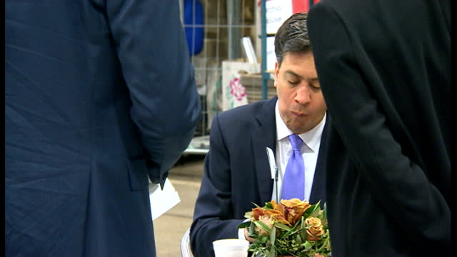 criticism of ed miliband from labour backbenchers lib / 2152014 new covent garden photography** ed miliband eating bacon sandwich manchester labour... - ed miliband stock-videos und b-roll-filmmaterial