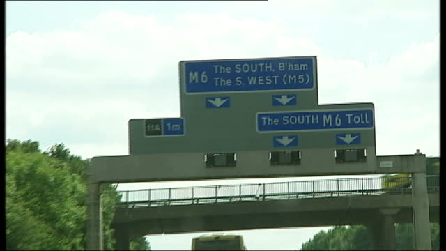 midlands m6 motorway ext pov tracking shot as travelling along the m6 around birmingham satellite navigation system in car reporter at wheel of car... - travelling light stock videos & royalty-free footage
