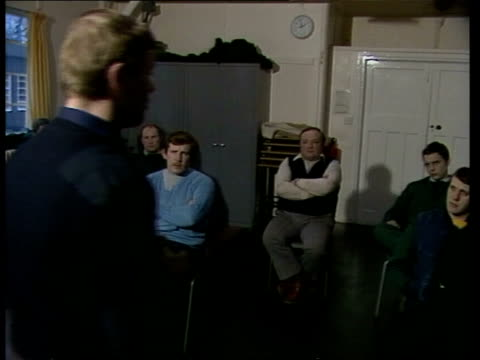 criticism over decision to put armed police on patrol in manchester; london: lippet's hill: int instructor r-l policeman at training course seated... - hill stock videos & royalty-free footage