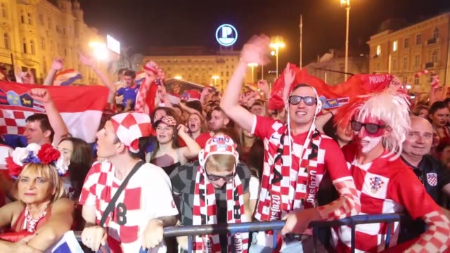 croatia fans celebrate at jelacic square after their team advanced to the semifinals at the 2018 fifa world cup russia on july 07 2018 in zagreb... - kroatien stock-videos und b-roll-filmmaterial