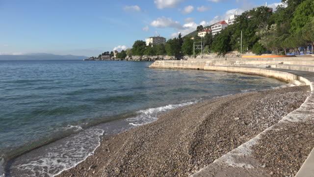 croatia low tide pebble beach at lovran sound - low tide stock videos & royalty-free footage