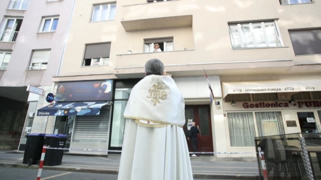 croatia priests bless zagreb residents from a distance on an easter sunday muted by coronavirus restrictions - soft focus stock videos & royalty-free footage