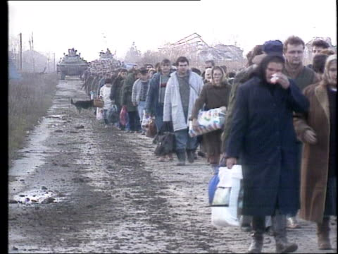 croatia: vukovar: ext croatian refugees leaving town after it was taken over by the federal yugoslav army - slobodan milosevic stock-videos und b-roll-filmmaterial