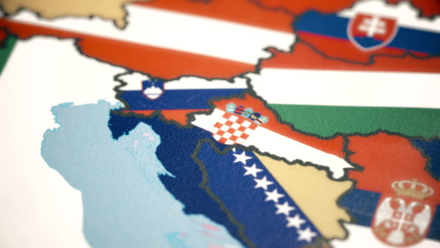 croatia with national flag on world map - serbia stock videos & royalty-free footage