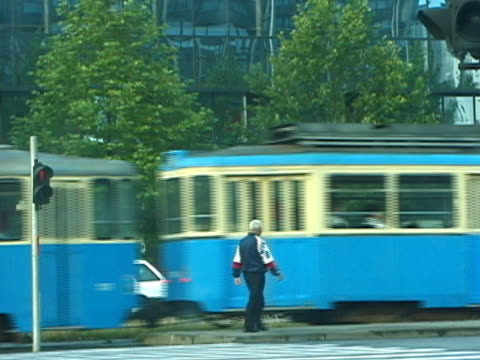 croatia: zagreb tram travels screen right - zagreb stock videos & royalty-free footage