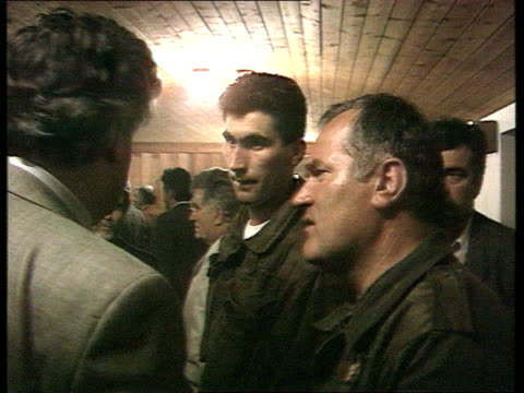 croatian and muslim troops continue fighting pale pale cms side radovan karadzic chatting gen ratko mladic in room full of people karadzic walks off... - bosnia and hercegovina stock videos & royalty-free footage