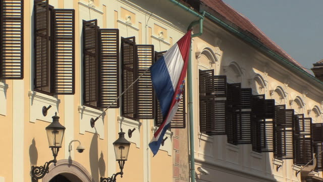MS Croatian flag flying from government building in St Mark's square / Zagreb, Croatia