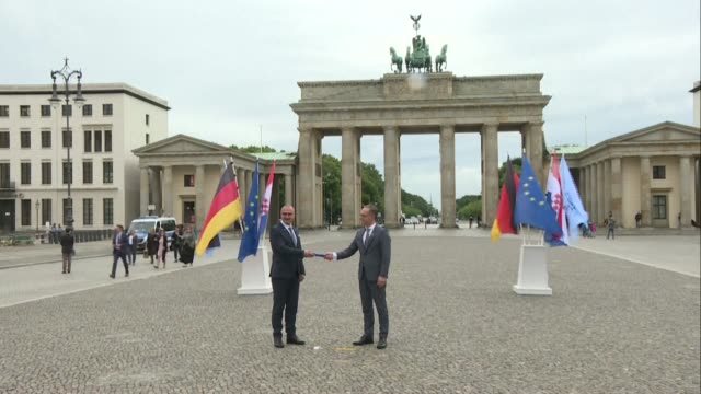 stockvideo's en b-roll-footage met croatian foreign minister gordan grlićradman symbolically passes the relay of the european union's rotating presidency to german foreign minister... - teamevenement