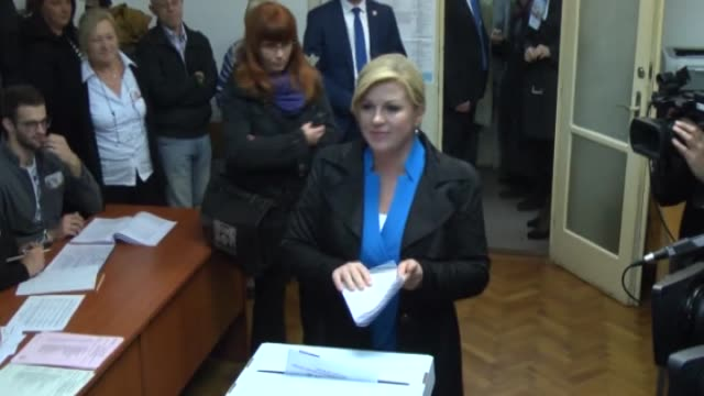 croatian president kolinda grabarkitarovic casts her ballot for the parliamentary elections at a polling station in zagreb croatia on november 08 2015 - zagreb stock videos & royalty-free footage