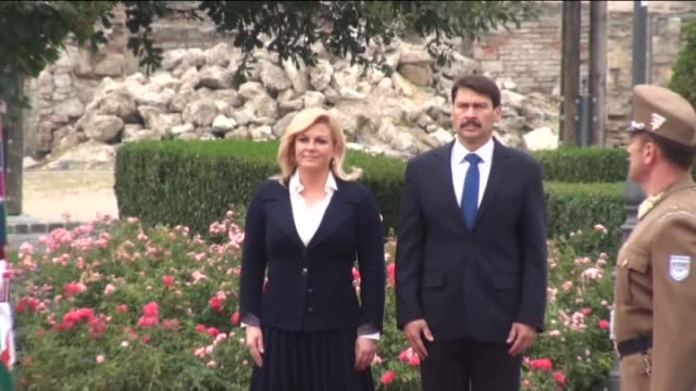 croatian president kolinda grabarkitarovic is welcomed by hungarian president janos ader ahead of their meeting in budapest hungary on october 07... - traditionally hungarian stock videos & royalty-free footage