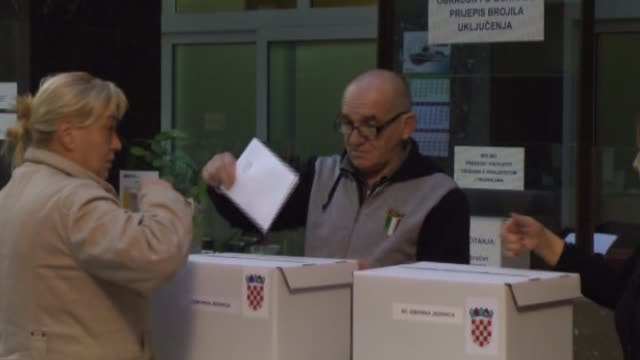 croatians cast their ballot for the parliamentary elections at a polling station in zagreb croatia on november 08 2015 - zagreb stock videos & royalty-free footage
