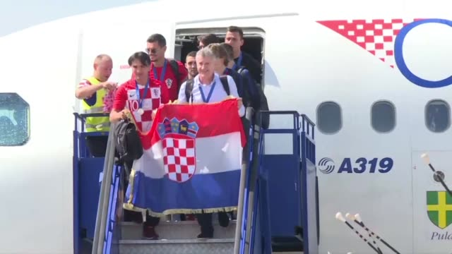 croatia's national football team lands in zagreb airport as a crowd in the city's jelacic square cheer while watching their arrival on a big screen... - homecoming stock videos & royalty-free footage