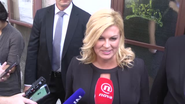 croatia's president kolinda grabar kitarovic casts her vote at a polling station during the parliamentary election in zagreb croatia on september 11... - zagreb stock videos and b-roll footage
