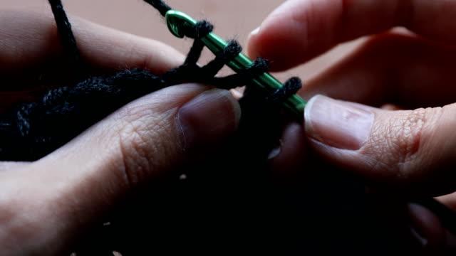 crochet with black yarn - knitting stock videos & royalty-free footage