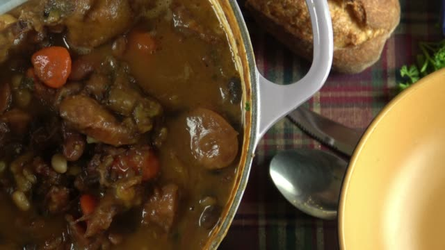 crock pot stew with meat, beans and vegetables - french food stock videos & royalty-free footage