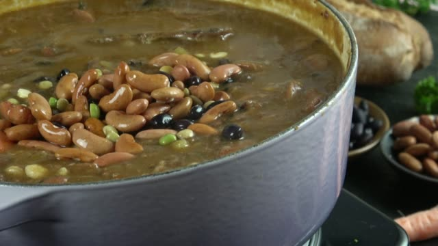 crock pot stew with meat, beans and vegetables - soup stock videos & royalty-free footage