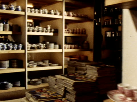 crockery and kitchen items are displayed on the shelves of a homeware shop - homeware stock videos and b-roll footage