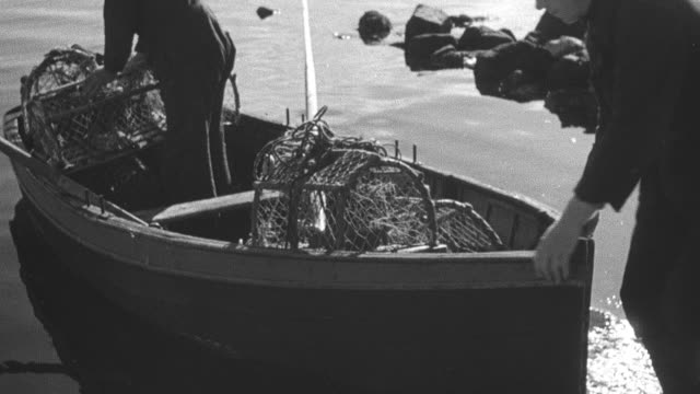 1944 montage crofter gathering lobster traps in row boat and pushing off from shore, paddling in loch inchard / achriesgill, scotland, united kingdom - achriesgill stock videos & royalty-free footage