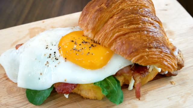 croissant sandwich with scrambled eggs. - bacon stock videos & royalty-free footage