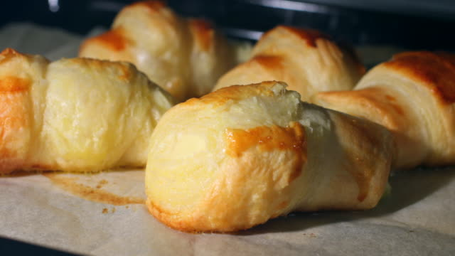 croissants and puffy pastry baked 4k - croissant stock videos & royalty-free footage