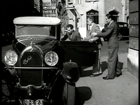 vídeos y material grabado en eventos de stock de de-feu mobilizing: section leaders in meeting people gathering staff cars drivers given directions members getting into cars long line of cars on... - 1934