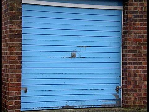john west commits suicide england gloucestershire gloucester house zoom in garage where john west was found hanged cs padlocks on garage door cms... - 性的虐待点の映像素材/bロール