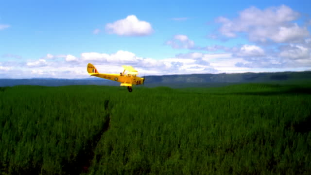 ws, ts, crop duster aircraft flying above field, new zealand - crop sprayer stock videos and b-roll footage