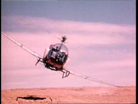 vídeos de stock, filmes e b-roll de a crop duster flies over a field - pano de pó