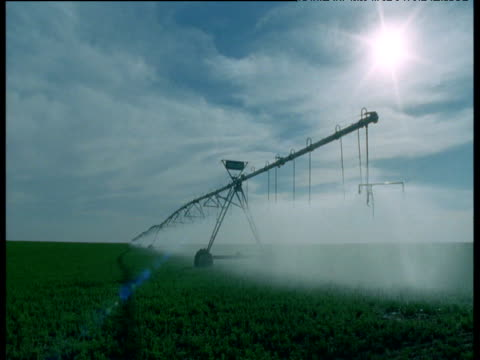 crop sprayer moves across pivot irrigation field, arizona - 2000s style stock videos & royalty-free footage