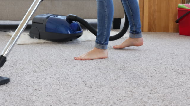 Cropped footage of person hovering the carpet