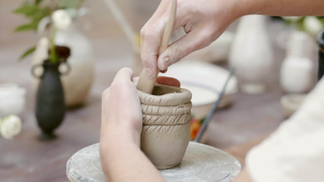 cropped hands molding clay bowl with work tool - clay stock videos & royalty-free footage