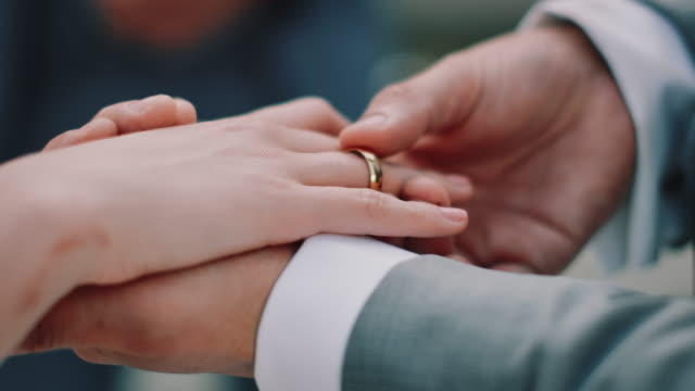 cropped hands of couple exchanging wedding rings - married stock videos & royalty-free footage