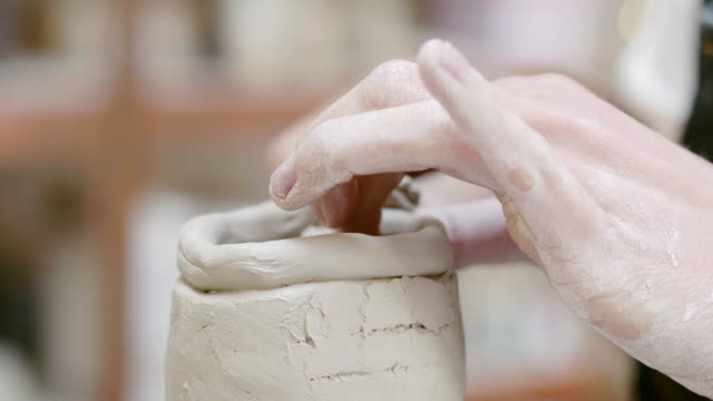 cropped messy hands making clay bowl in studio - clay stock videos & royalty-free footage