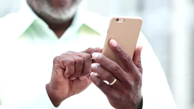 cropped senior african-american man using smart phone - dialling stock videos & royalty-free footage