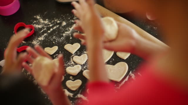 cu cropped shot of mother teaching her daughter how to make cookies. - baking stock videos & royalty-free footage