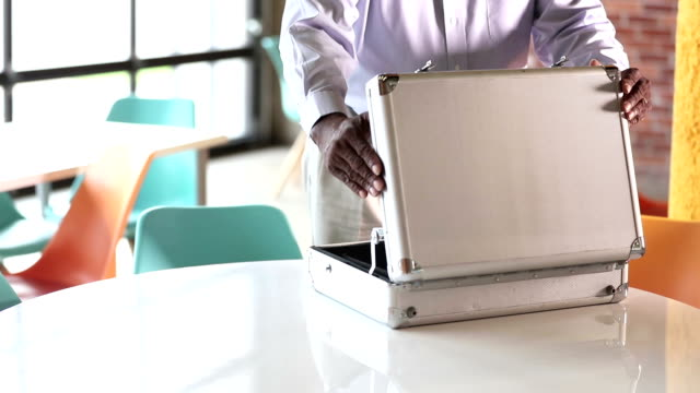 cropped view of african-american man opening briefcase - briefcase stock videos & royalty-free footage