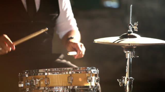 cropped view of hispanic man playing drums - jazz video stock e b–roll