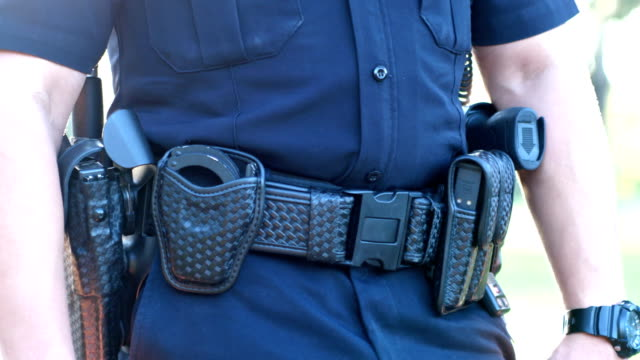 Cropped view of police officer duty belt